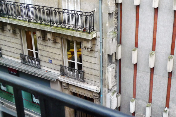 Man in a window in Paris
